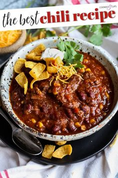 This is the absolute BEST Chili Recipe ever. My chili is filled with shredded beef, tons of flavor, and is easy enough to make on the stove top or in the slow cooker! This isn't your average chili, so be prepared to win your next chili cook off! #cookiesandcups #chili #chilirecipe