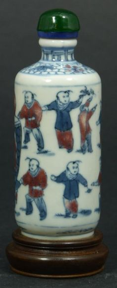 Chinese hand painted enameled porcelain snuff bottle depicting a boy's festival scene