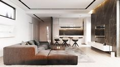 Two tours around two open plan apartments that are distinctly masculine in approach, each with a grey, black and brown colour scheme. However, these two monochr