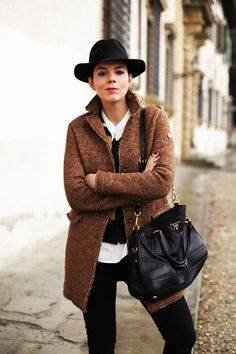Ready for the day! This brown coat by Swiss Chriss is great for wearing over thin layers or as an overcoat on top of a thick jumper for Winter. My bag is by Prada :)