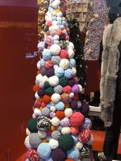 Alternative Christmas tree made from balls of wool! Now I know what to do with my stash!