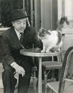 French writer and poet Jacques Prévert discussing with kitty.