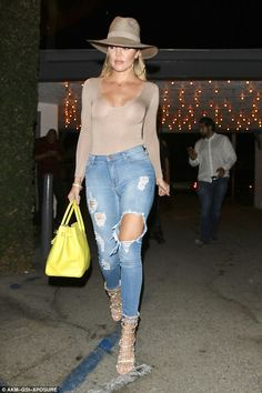 Flashing what she's got: Khloe Kardashian, 32, went braless as she made her way to dinner ...