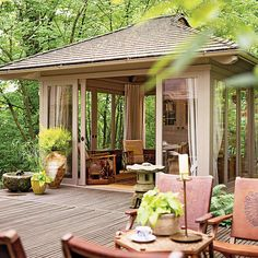 Create added privacy and protection to your pavilion with sliding glass doors and full-length curtains. The doors can easily be left wide open to allow the shaded area to flow easily into the deck, but the doors can close out the sun or mosquitoes. Similar hues are used on both the deck and pavilion to ensure continuity throughout the space.