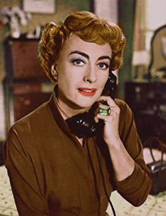 Joan is on the phone calling the fan magazines, to have them print a story about her great LOVE for all her fans!