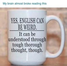 Coffee mug that explores the English language on just on side of the cup.