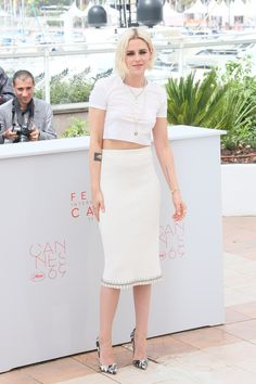Kristen Stewart in a Chanel skirt from the Spring/Summer 2016 collection, a t-shirt from the Fall/Winter 2016-2017 collection and Chanel jewelry.