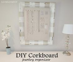 DIY Framed Cork Board Jewelry Organizer...I've seen a ton of these, but this one caught my eye...it is quite pretty.