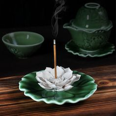 Lotus Incense Holder  The set includes:1 incense burner  The measurement of each item are as follows: size:Width 10.5 cm (4.1), Height 2 cm (0.8) Ceramic plate with three holes for 1-3 incense stick. The delicate design reflects the art of nature - Chinese style  Free Global Shipping:China Post