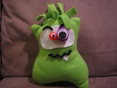 Ugly Monster craft for elementary school kids.  They used buttons, ric-rac, felt, and googly eyes to make their own faces.  I left the top open so they could stuff it after they decorated.  I used pinking shears to cut strips and they tied knots on top (like the no-sew pillows) which made the hair.  The kids had a blast!