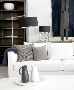 clean contemporary styling for the living room - fabulous palette of grey, black and white with natural woods