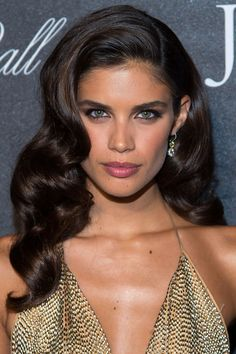 Who: Sara Sampaio What: Disco Glitz How-To: The model brought '70s glamour to the Angel Ball with a plunging gold neckline, darkly-lined eyes and big, disco waves like the ones seen on the spring runways at Sonia Rykiel and DVF. Things just get better as the waves fall and the eye makeup gets smokier throughout the night, making it the perfect dance floor beauty look. Editor's Pick: GHD Curve Soft Curl Iron 1.25, $245, sephora.com.
