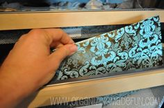 """To keep the drawers more """"private"""" and pretty, I cut cardboard to fit the front of the drawer and then wrapped with pretty wrapping paper."""
