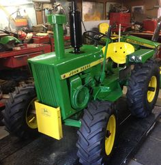 Here is my jd 110 round fender tractor converted over to a mini 4020.