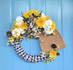 Bee Skeps are so popular right now for decoration and I wanted something incorporating them to go on my front door! Start with a bee skep-shaped piece of&nbsp… Mason Jar Flowers, Flower Pots, Umbrella Wreath, Terracotta Plant Pots, Straw Wreath, Bee Skep, Sola Wood Flowers, Stenciled Floor, Scrap Material