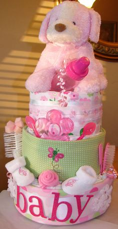 diaper cake is one of the best baby shower gift ideas and ideal for baby shower decor. I searched for this on /images Regalo Baby Shower, Baby Shower Diapers, Baby Shower Cakes, Baby Shower Parties, Baby Showers, Diaper Shower, Best Baby Shower Gifts, Baby Gifts, Baby Girl Cakes