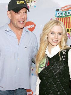 Actor Bruce Willis (L) and singer Avril Lavigne arrive at the 19th Annual Kid's Choice Awards held at UCLA's Pauley Pavilion on April 1, 200...