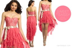 Camille La Vie High Low Prom Dress in Coral color. Features a Ribbon belt and tiered skirt