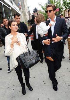 Kourtney in a TT Collection top (DASH), Alice and Olivia leggings, Chanel boots, Celine bag and Push earring