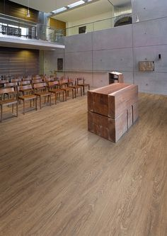 Affinity255 Hazel Oak luxury vinyl tile flooring in lecture theatre