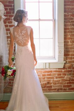 lovely wedding gown with back embroidery #weddinggown #bride #weddingchicks http://www.weddingchicks.com/2014/03/10/art-deco-wedding-ideas/