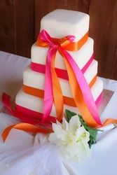 Square 4 Tier Wedding Cake With Hot Pink And Bright Orange Ribbons Different Color
