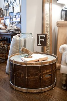 An old drum recycled into a decorative table....I LOVE this idea!!
