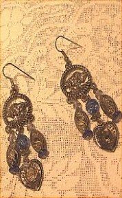 Unique pierced earrings have buffaloes, hearts and more.   More information given on my website http://barbspencerdolls.com If you are overcharged on shipping costs, I make refunds.
