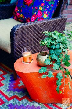 Make a color statement! Paint an old tree stump in a bright hue: poppy orange used here! Click through to see more photos of Justina Blakeney's colorful and eclectic patio. (@Justina Siedschlag Blakeney)