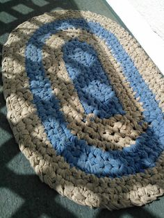 Crochet rag rug made from old bed sheets. Finished in about 4 hours. Used 1 twin sheet and 1 queen sheet ripped into 1 1/2 in strips.