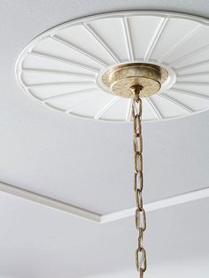 Architectural details are a great way to make a home look expensive. Turn the ceiling into a focal point with this simple trick: Embellish the area around a light fixture's attachment with a lightweight, polyurethane ceiling medallion. Home Ceiling, Ceiling Rose, Ceiling Decor, Ceiling Design, Ceiling Lights, Ceiling Ideas, Modern Ceiling Medallions, By Any Means Necessary, Art Deco