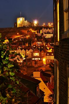 Whitby at night with St Mary's church at the top of the East cliff, near the Abbey. It is magical.