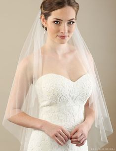 Enhance your wedding day style with a luxurious veil. Soft, luxe tulle in a simple cut edge design creates a beautiful addition to your bridal ensemble. Add the accessories of your choice to completely personalize your look.