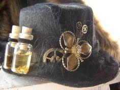 http://orig13.deviantart.net/64b4/f/2010/183/e/7/large_picture_steampunk_hat_by_lonespiritwolf.jpg