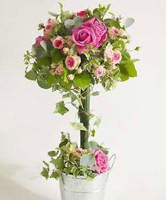 Step-by-step flower arranging: pretty rose lollipop centrepiece :: allaboutyou.com