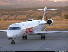 Air Canada Jazz Bombardier CRJ-705ER (CL-600-2D15) C-GJJZ pulling up to the gate at Whitehorse-International, September 2006. (Photo: James Connor)