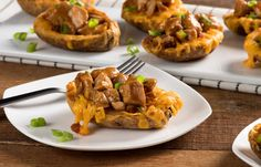 Tasty BBQ Chicken Potato Skins are a creative way to enjoy National BBQ Month and Loaded Potato Month in May. YUM!