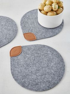 This beautiful felt and leather trivet has been created by a Danish designer whose passion is designing every day objects with a sense of nostalgia and function, for the modern era.