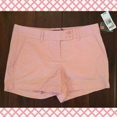 Vineyard Vines CUTE Pink Cotton/Spandex Shorts This is a really cute pair of classic Vineyard Vines pink shorts that are NWT!! They have 4 pockets and a flat front with a zipper, hook & eye and 2 button closure. They have belt loops and two buttons at the waist and the logo in blue over one back pocket. Don't miss out on this great pair of shorts at an awesome price! They are in brand new condition and come from a pet and smoke free home.  SB  Waist lying flat: 16 in  Inseam: 3.5 in  Rise…