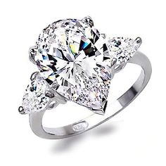 Pear engagement rings with 2 smaller pear diamonds on side.