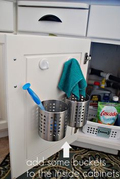 Genuis! Use 3M sticky tape to add small buckets to the inside of cabinets. Via Tatertos and Jello.