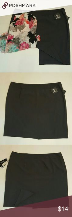 Cute skirt Nice tummy slimming mid length skirt,has a nice stretch w/small slit in back,no trades Skirts Midi