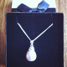 Very elegant: a silver pendant with pink drop pearl on a silver chain $176.95