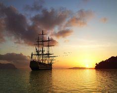 Фото Деревянный корабль направленный на восход солнца