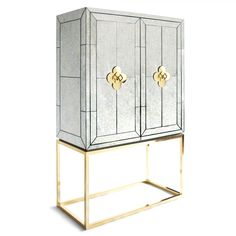 Modern Furniture | Delphine Bar | Jonathan Adler. Technically a bar but would be fantastic as a makeup or jewelry armoire. Way too expensive, though.