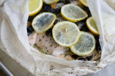 Salmon baked in a bag with citrus, olive and chilies. The bag keeps the flavor and moisture trapped inside during cooking, allowing the juices from the fish and the other ingredients to mingle and become a wonderful sauce.