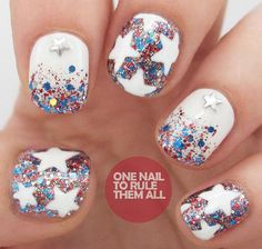 This super-detailed 4th of July nail art from One Nail to Rule Them All is simpler than it seems. Red and blue glitter polish, a white base coat, and a white nail art pen are all it takes to snag this sparkling look. Adding some star-shaped nail stickers seals the deal!