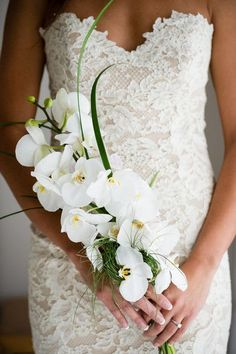 Unique, sophisticated and simple white orchid wedding bouquet {Misha Media Photography}