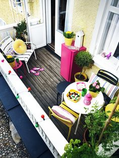 The vibrant furniture on this balcony makes for a really fun space. It is all part of the IKEA summer collection.