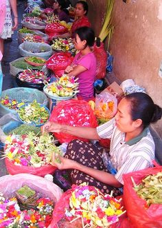 Flower market in Bali. They mostly sell offerings consisting of flower petals in a container woven from young coconut leaves.